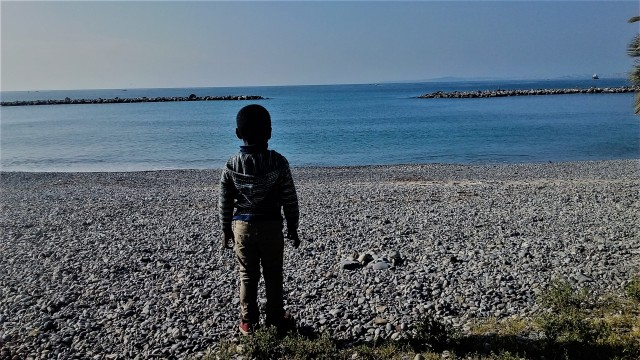 The little boy and the sea. St. Laurent Du Var Beach