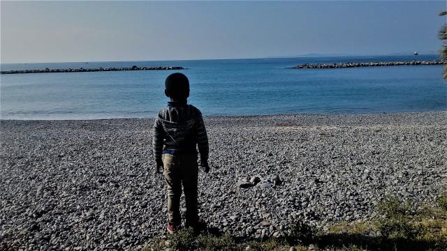 The little boy and the sea. St. Laurent Du Var Beach